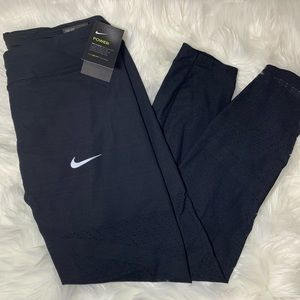 The Nike Epic Lux Tight Fit Mesh Bottom Legging